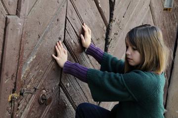white girl opening old door