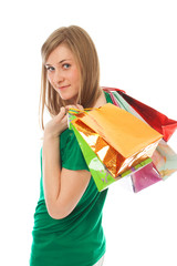 The beautiful girl with packages isolated on a white