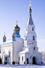 White church with gold domes
