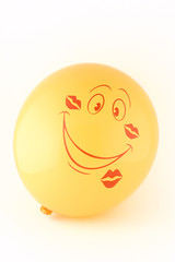Smiling yellow balloon in the imprints kisses