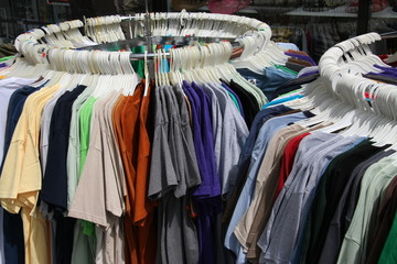 Racks of T-shirts outside store