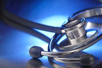 medical stethoscope on blue background