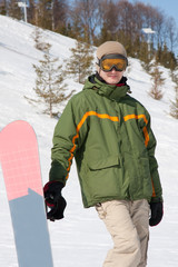 Young man with snowboard