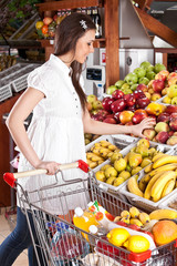 Woman choose food  in grocery supermarket