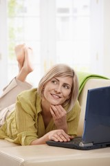 Woman chatting online on computer