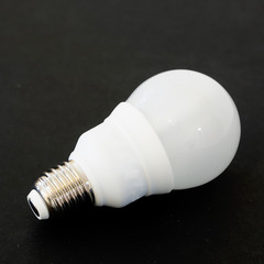 light bulb on dark black backdrop with copy space