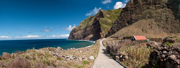 Cliffs surround a bay on Madeira Island, Atlantic ocean