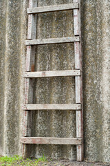 wooden ladder near old roofing slate