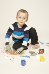 Boy painting with finger colors