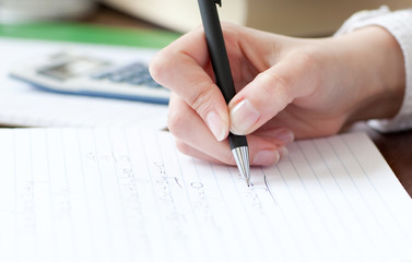Close-up of a student doing her homework