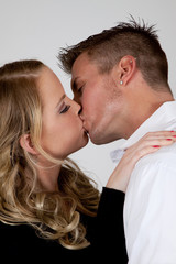 Romantic couple in a passionate embrace and kiss