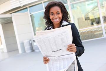 Pretty Business Woman Reading Newspaper