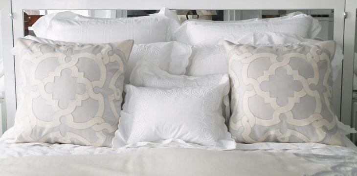 fancy pillows on the bed