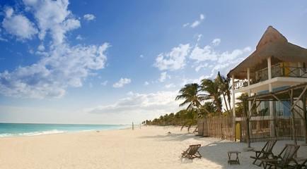 Caribbean sand beach tropical houses in Mexico