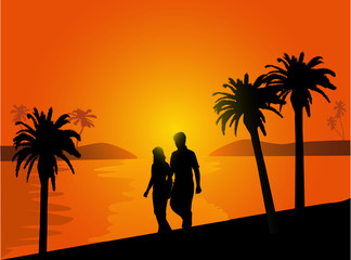 couple in love walking on the beach at sunset