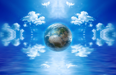 Earth globe floating in water