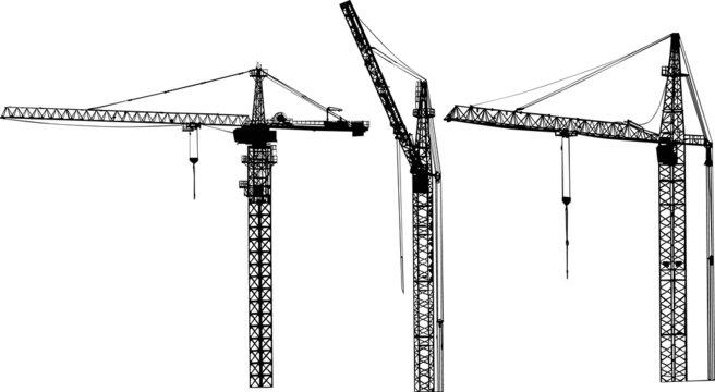 three isolated black building cranes