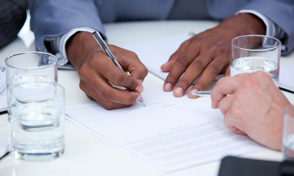 Close-up of ambitious business people closing a deal