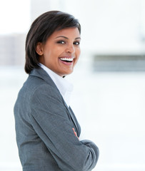 Portrait of a laughing business woman at work