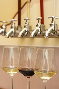 Glasses of wine under a few taps