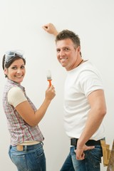 Happy couple improving home