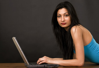 Female chatting on internet, copy space