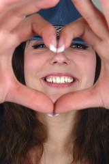 woman heart hand portrait
