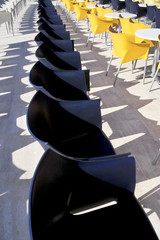 Row of blue and yellow chairs