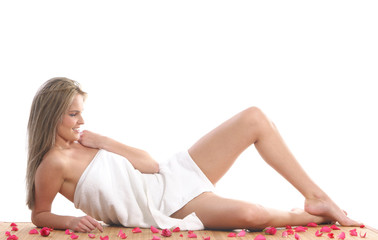 A young and beautiful blond lying in a towel