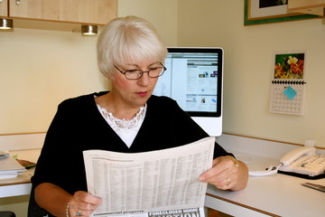 Woman reading Foreclosure news