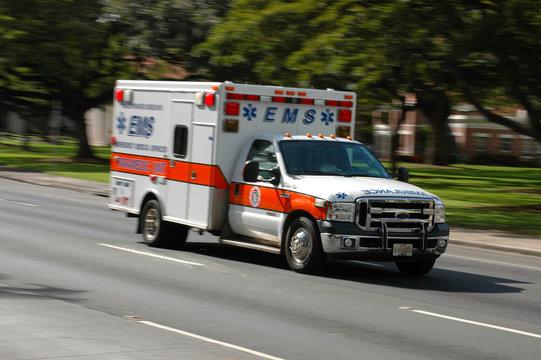 A speeding ambulance, with motion blur