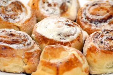 close-up walnut buns with powdered sugar