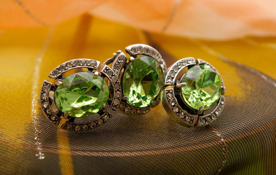 Jeweller set from silver with a green stone chrysolite