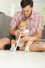 Father and baby girl reading story book