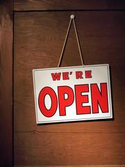 We are open door sign on wooden door