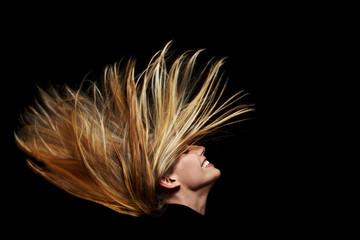 Lange fliegende blonde Haare