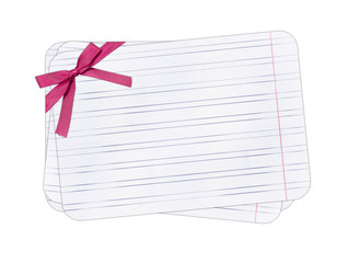 Note paper with rosy bow isolated background