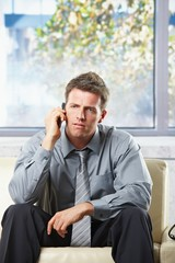 Troubled businessman on phonecall