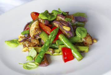 Grilled asparagus, eggplant and red pepper salad with pine nuts