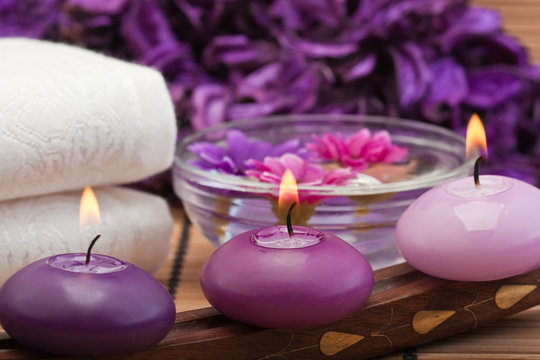 purple candles and flowers in spa setting (1)