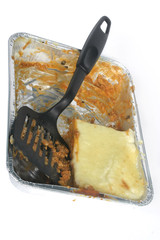 TV-dinner lasagna almost eaten with plastic blade