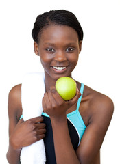 Afro-american fitness woman eating an apple