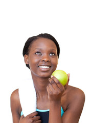 Charming fitness woman eating an apple