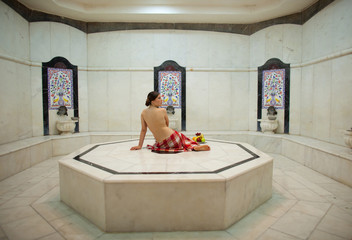 Beautiful young woman in turkish bath (Hammam)