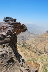 Lone car is standing on rock over breakaway