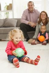 Smiling little girl with ball