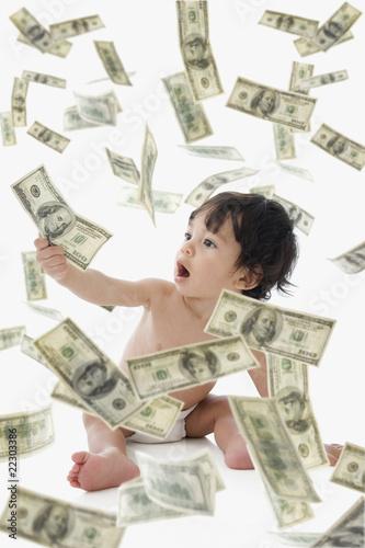 Money Raining Down On Hispanic Baby Stock Photo And Royalty Free