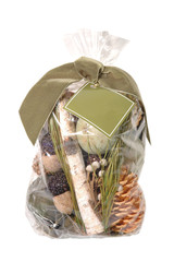 Pine cone and nuts potpourri wrapped gift bag