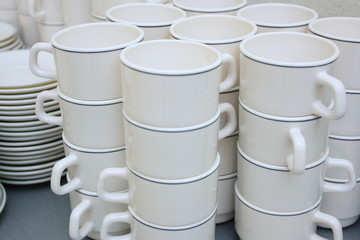 Pile of white clay cups for tea and coffee
