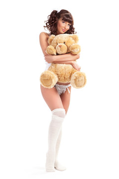 young woman embraces teddy bear